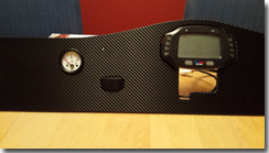 Covering the dashboard with the carbon fibre vinyl wrap - Click for larger image